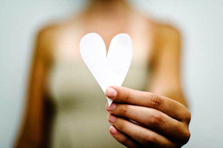 woman-heart-hand-gettyimages-97611594-cropped